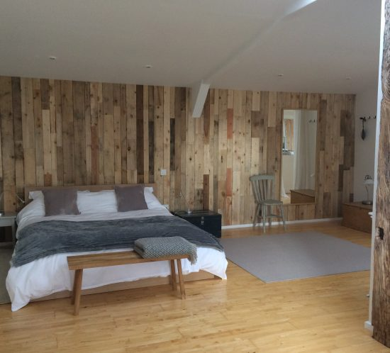 hen house bedroom with king sized bed and crisp, white bed linen