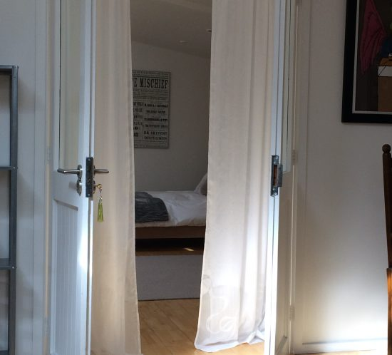 White wooden double doors into the bedroom at once a hen house