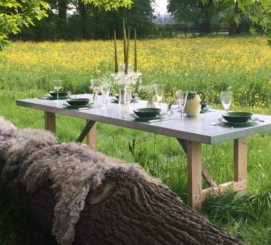 romantic al fresco dining table set up in hen house gardens for photo shoot